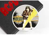 This officially licensed coin is struck from 1/2oz of fine silver to a proof finish and features the cover of AC/DC's first album High Voltage - Angus Young in his iconic schoolboy outfit. EL: 5000.