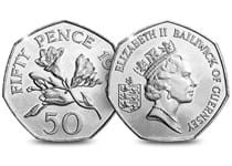 Guernsey Freesia Flowers 50p Coin. Reverse features Guernsey Freesia flowers, and the obverse features Raphael David Maklouf's engraving of Queen Elizabeth II and the lettering Bailwick of Geurnsey.