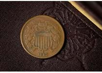 "This is an example of the first coin to feature the phrase ""In god we trust"". This is the official motto of the United States and has been used on coins since 1864. Comes in leatherette box with COA."